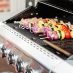 Grilling skewers on a propane grill
