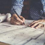 Architect drawing blueprint